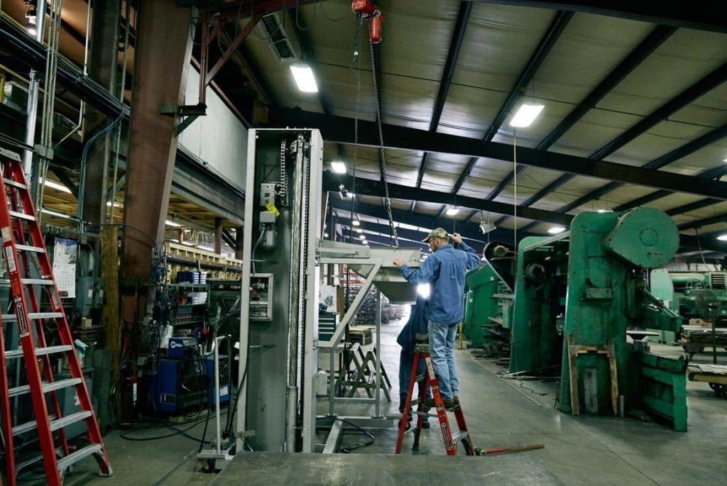 EnSight Solutions engineer reviewing industrial equipment